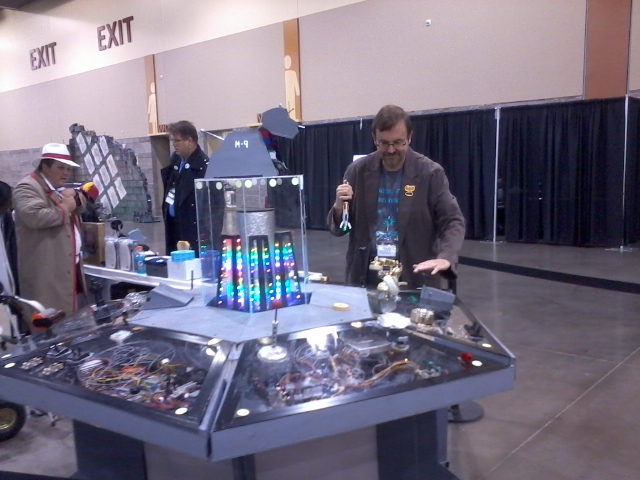 David at the Tardis Console.  The Doctor looks on with concern.