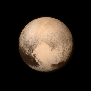 This July 13, 2015 image provided by NASA shows Pluto, seen from the New Horizons spacecraft. (NASA via AP)